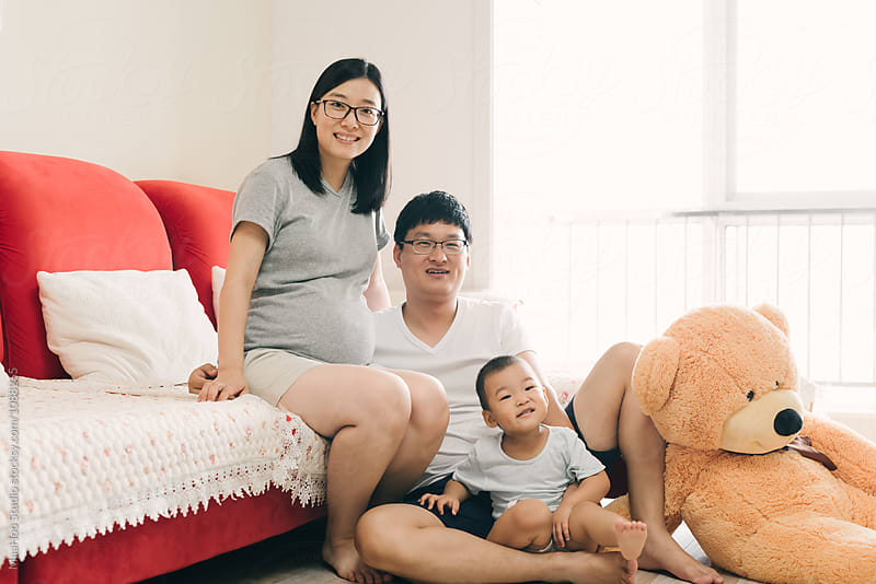 Portrait of a young Chinese family by Maa Hoo for Stocksy United