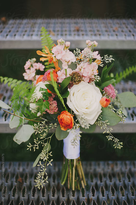 Pretty and feminine wedding bouquet flower arrangement by Daring Wanderer for Stocksy United