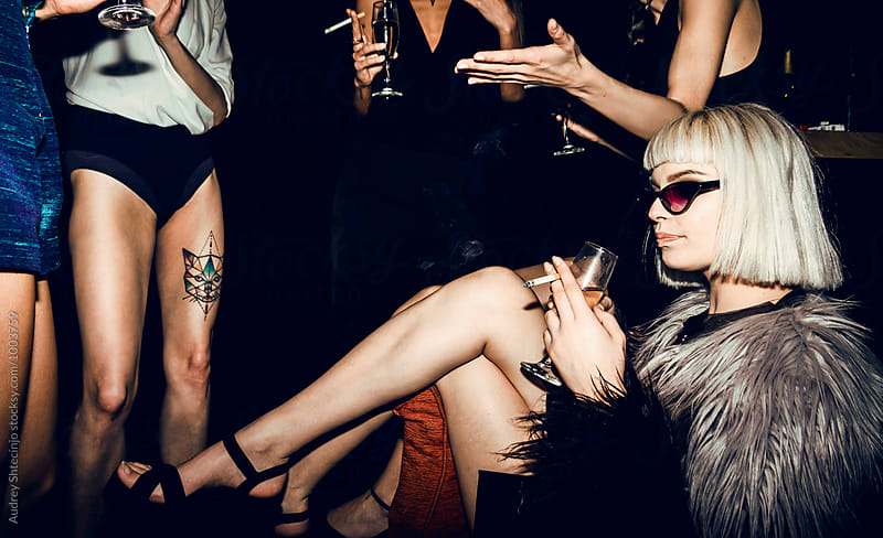Posh blonde female at party. by Audrey Shtecinjo for Stocksy United