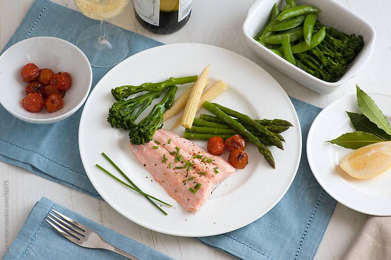 steamed salmon fillet with fresh vegetables by Lee Avison for Stocksy United
