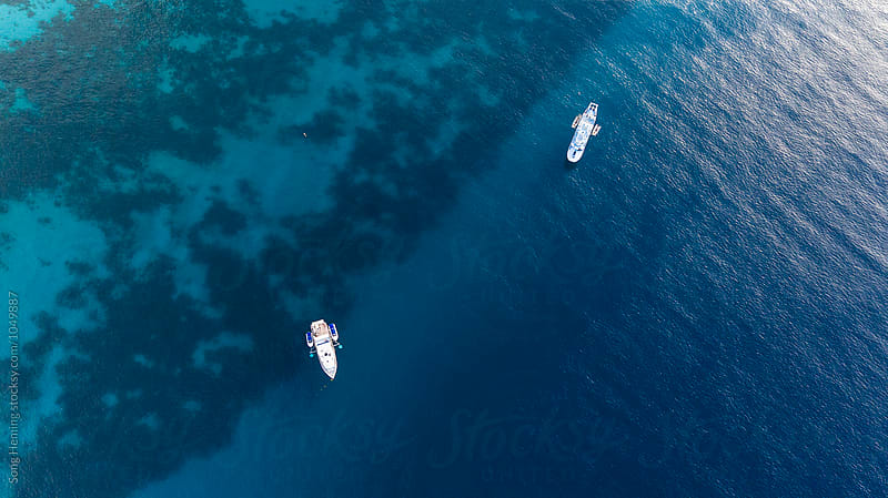 Beautiful aerial view of a coastline with two yachts by Song Heming for Stocksy United