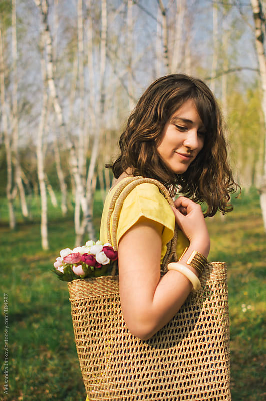 Pretty girl holding bag with flowers by Aleksandra Jankovic for Stocksy United