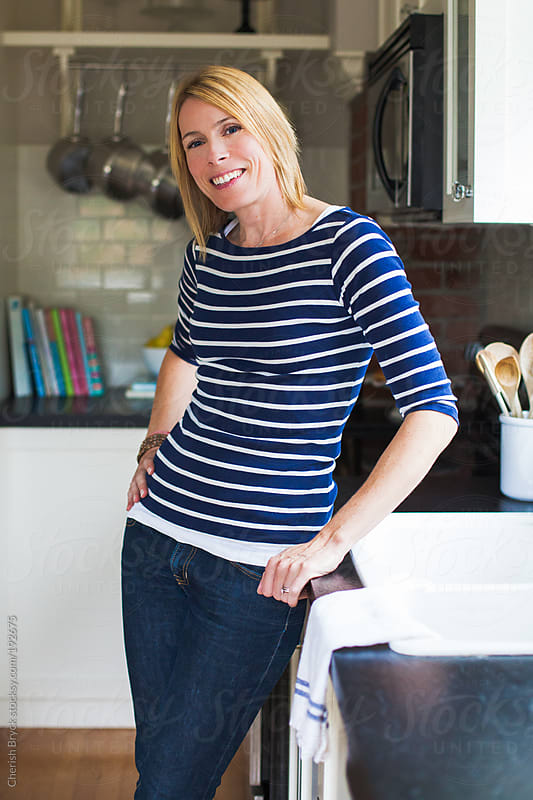 Comfy and stylish in the kitchen. by Cherish Bryck for Stocksy United