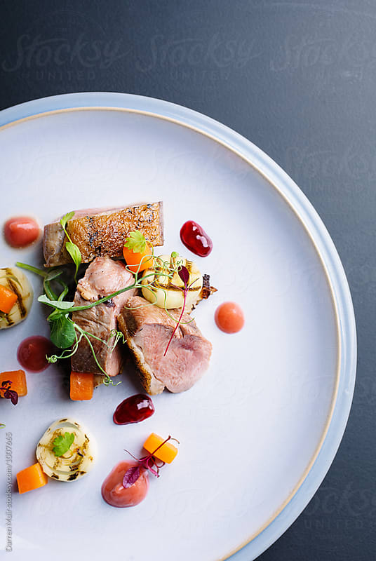 Delicious homemade roast duck breast meal on a plate. by Darren Muir for Stocksy United