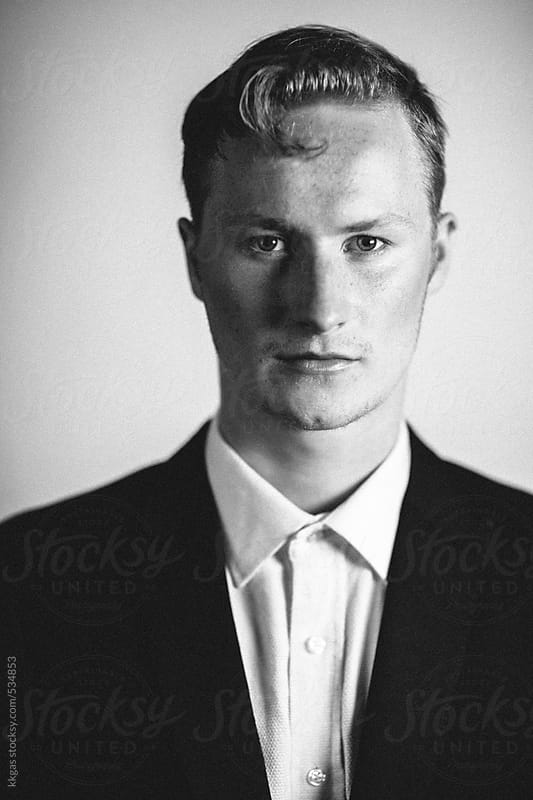 black and white portrait of a young man by kkgas for Stocksy United