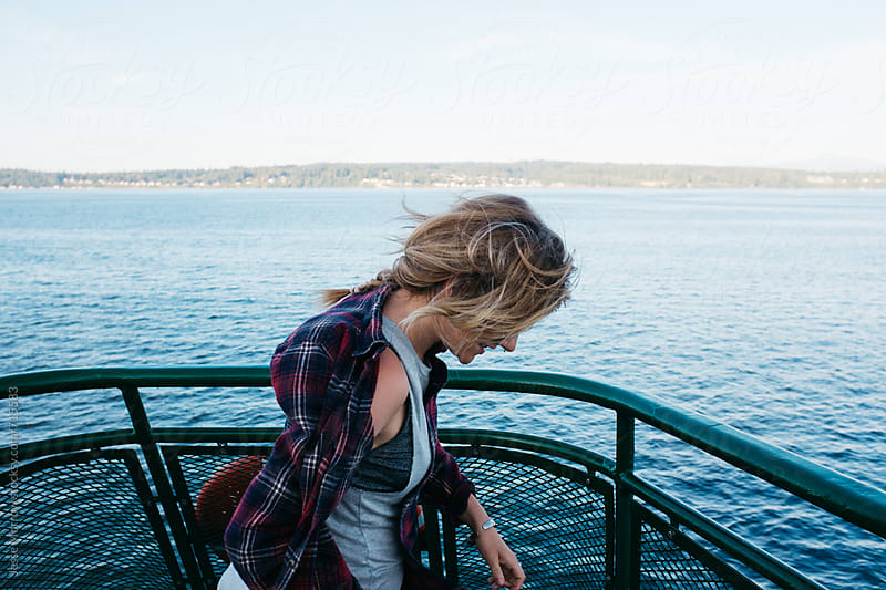 portrait of young female traveling on ferry by Jesse Morrow for Stocksy United