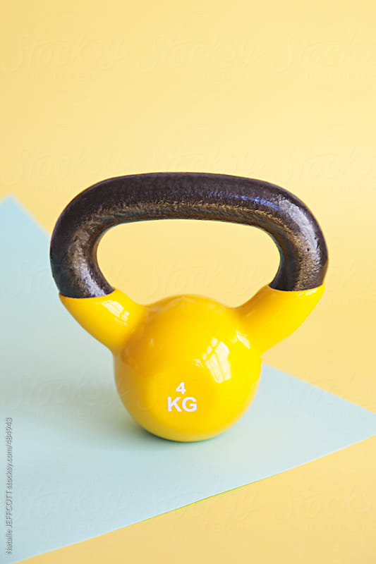fitness weights and equipment on table top by Natalie JEFFCOTT for Stocksy United