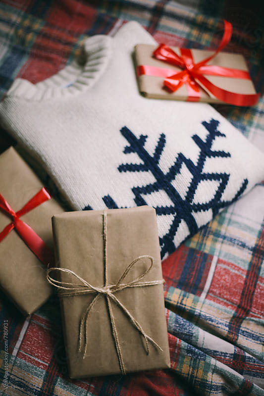 Christmas gifts and sweater on a natural light  by Marija Mandic for Stocksy United