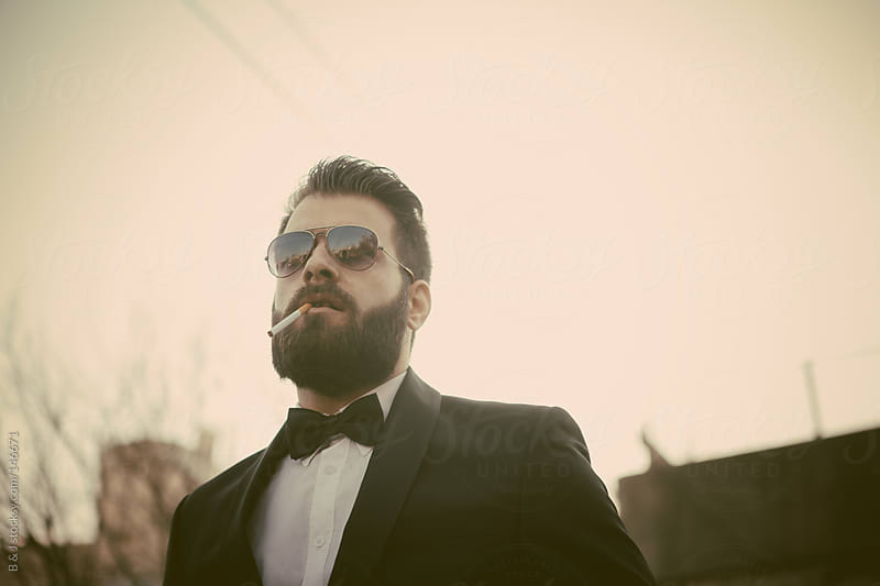 young man wearing tuxedo  by B & J for Stocksy United