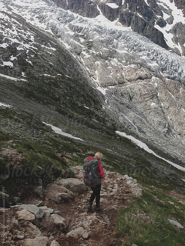 Young Woman Trekking in the Alps by Neil Warburton for Stocksy United