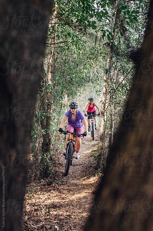 Two female mountain bike riders by Gabriel (Gabi) Bucataru for Stocksy United