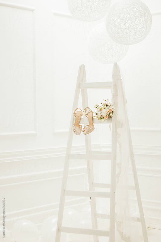 Bride's Bouquet, Veil and Shoes on a White Ladder by Lumina for Stocksy United