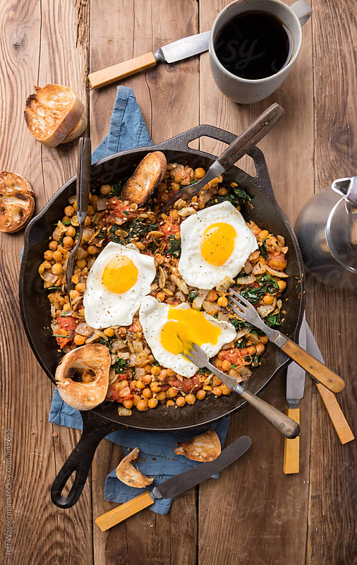 Spinach With Chickpeas And Fried Eggs by Jeff Wasserman for Stocksy United