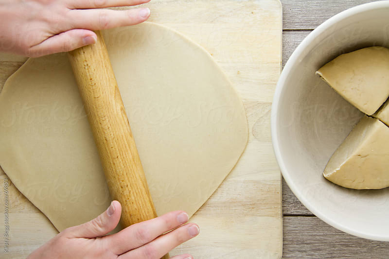 Rolling pastry for pies (pasty) by Kirsty Begg for Stocksy United