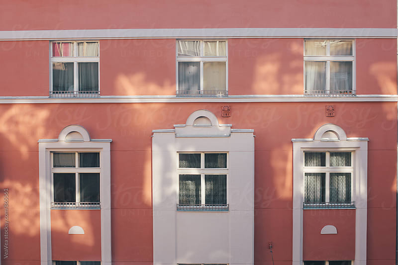 Red building with shadows  by VeaVea for Stocksy United