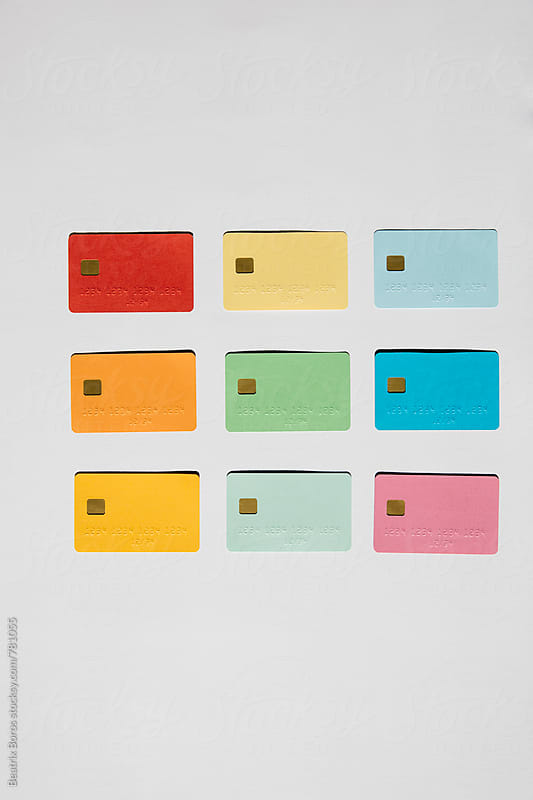Credit cards in 3 rows and colums by Beatrix Boros for Stocksy United