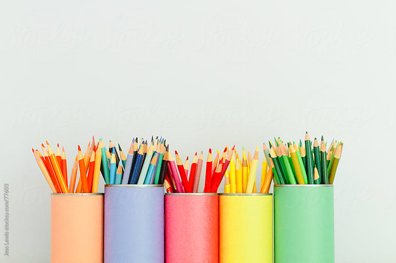 bright colored pencils in matching containters by Jess Lewis for Stocksy United