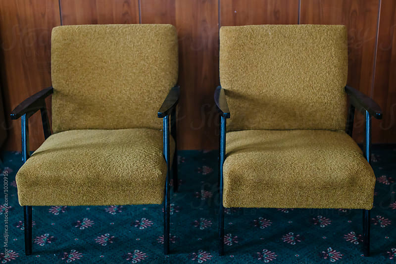 Two empty chairs,couple,old age,interior,death,alone,style,different by Igor Madjinca for Stocksy United