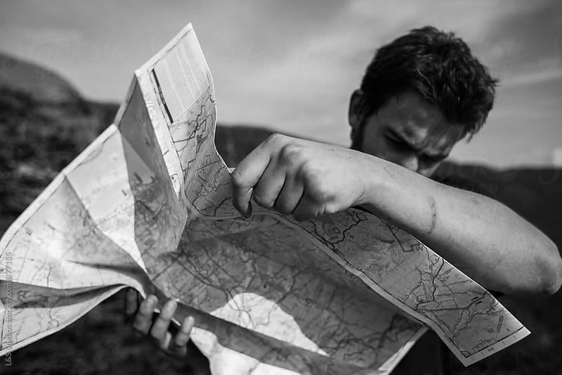 Man looking at map by L&S Studios for Stocksy United