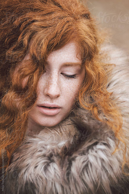 Portrait of a redhead in a fur coat by Maja Topcagic for Stocksy United