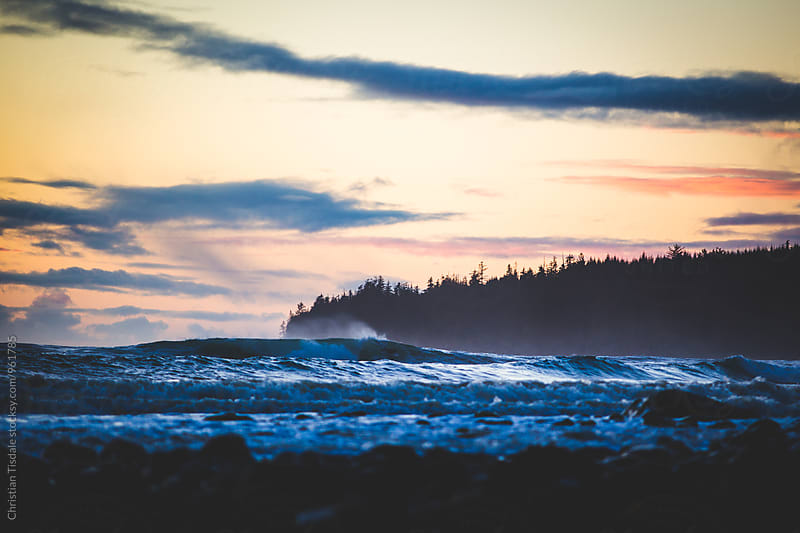 Waves crashing at sunset in BC by Christian Tisdale for Stocksy United