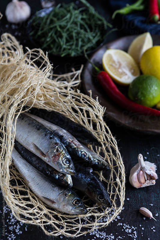 Fresh sardines with lemon, chilies, samphire by Aniko Lueff Takacs for Stocksy United