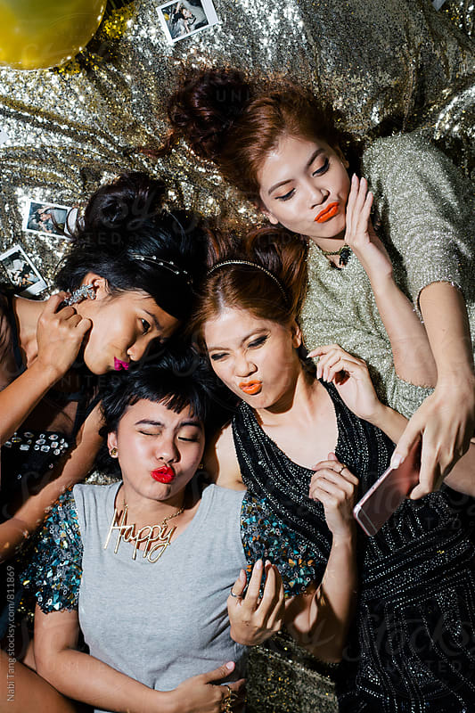 Girls making duck face for self portrait by Nabi Tang for Stocksy United