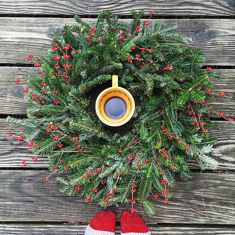 Morning coffee with a Christmas Wreath by Holly Clark for Stocksy United