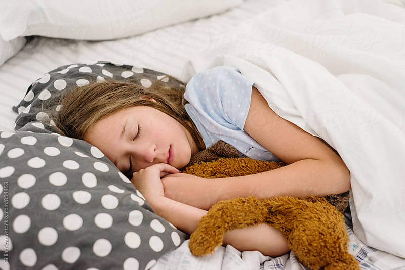 sleep girl with her favourite toy by Gillian Vann for Stocksy United