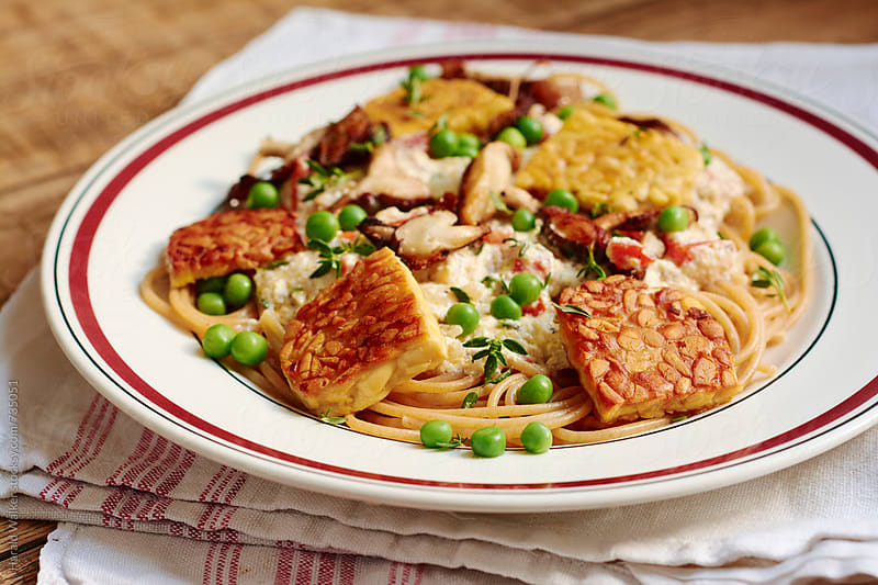 Tempeh and Shiitake Pasta Alfredo by Harald Walker for Stocksy United