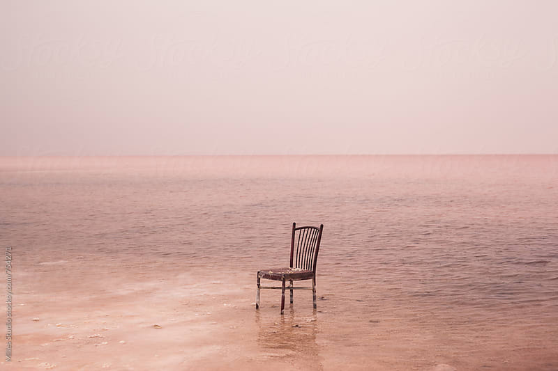Broken chair in pink lake by Milles Studio for Stocksy United