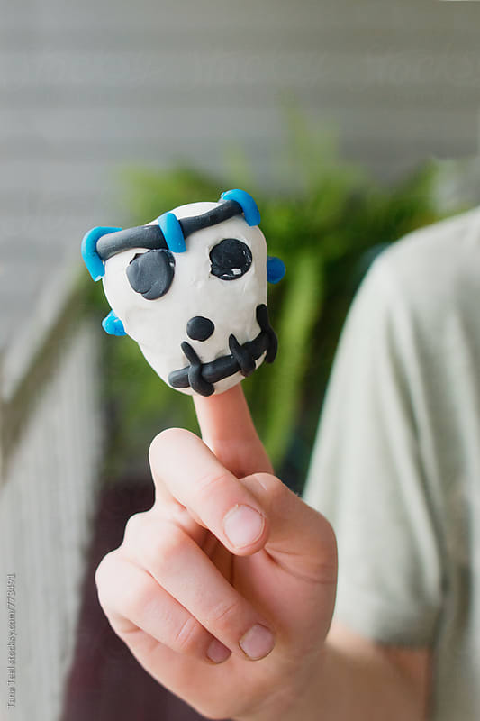 Handmade finger puppet  by Tana Teel for Stocksy United