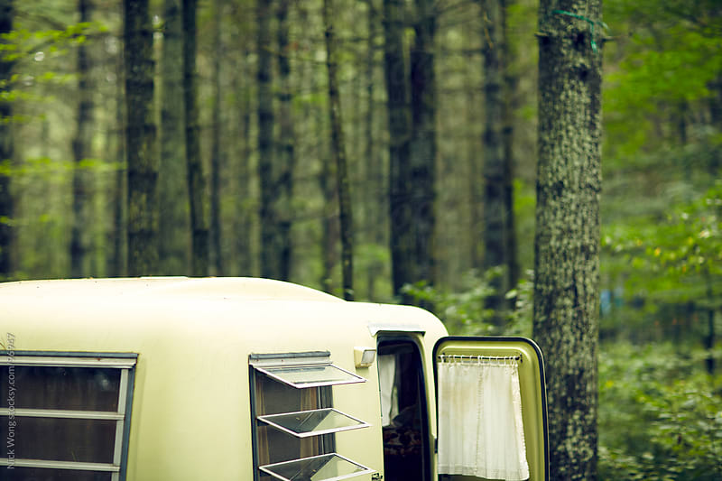 Vintage Trailer camping in forest by Nick Wong for Stocksy United