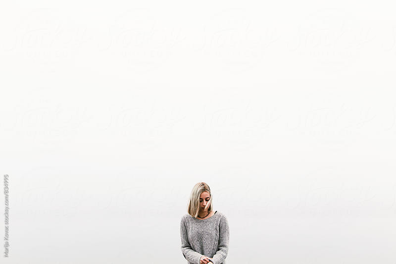 Young blonde woman outdoor during the fog - horizontal by Marija Kovac for Stocksy United
