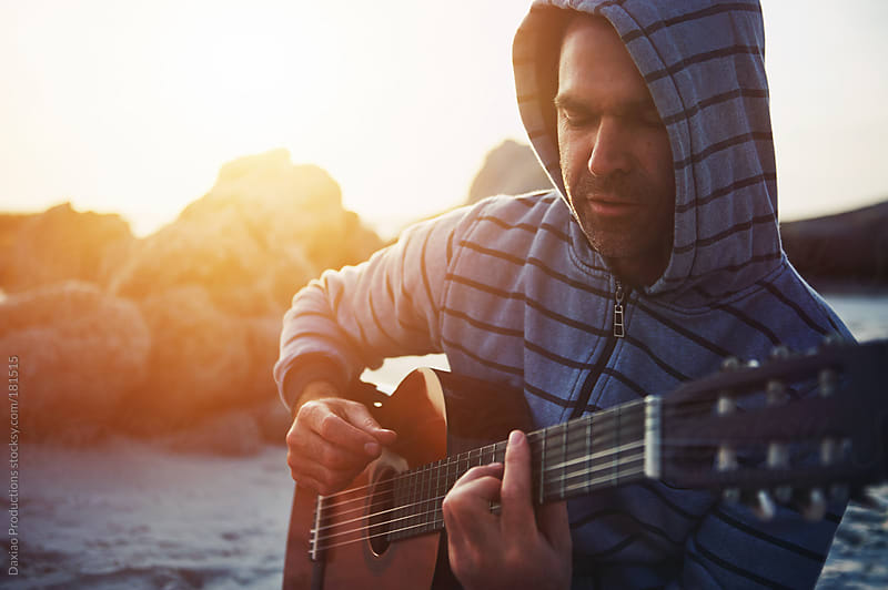 beach guitar man by Daxiao Productions for Stocksy United