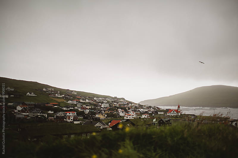 Red Church on the Side of a Cliff over the Atlantic Ocean in the Faroe Islands by Rachel Gulotta Photography for Stocksy United