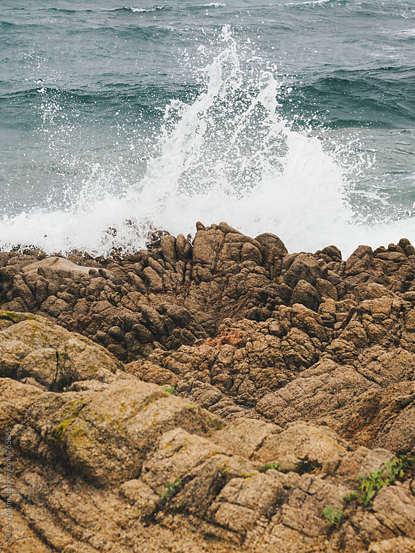 waves crushing on the rocks by Milena Milani for Stocksy United