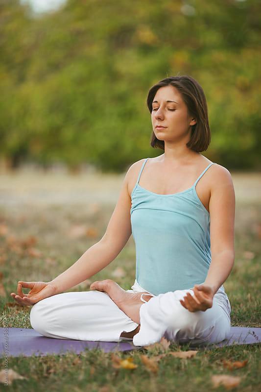 Caucasian Woman Meditating Outdoors by Lumina for Stocksy United