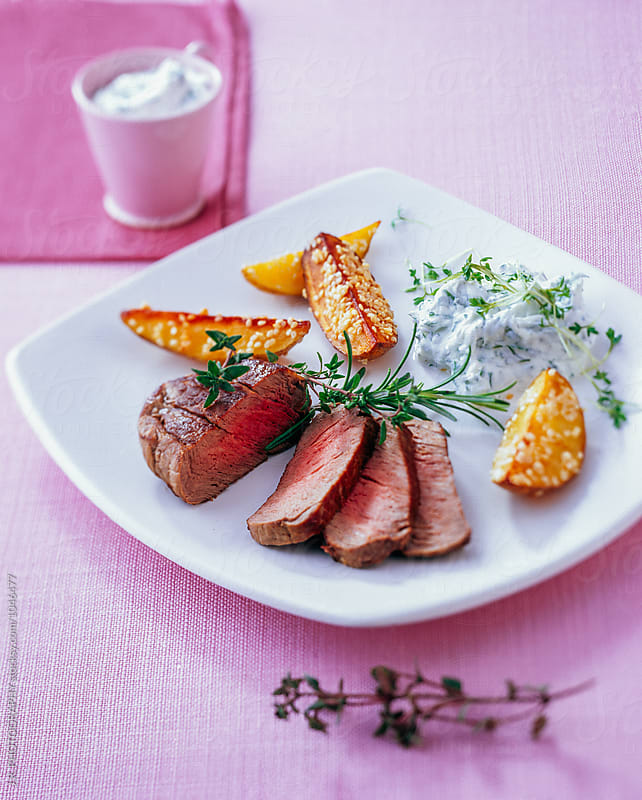 Steak with potato wedges by J.R. PHOTOGRAPHY for Stocksy United