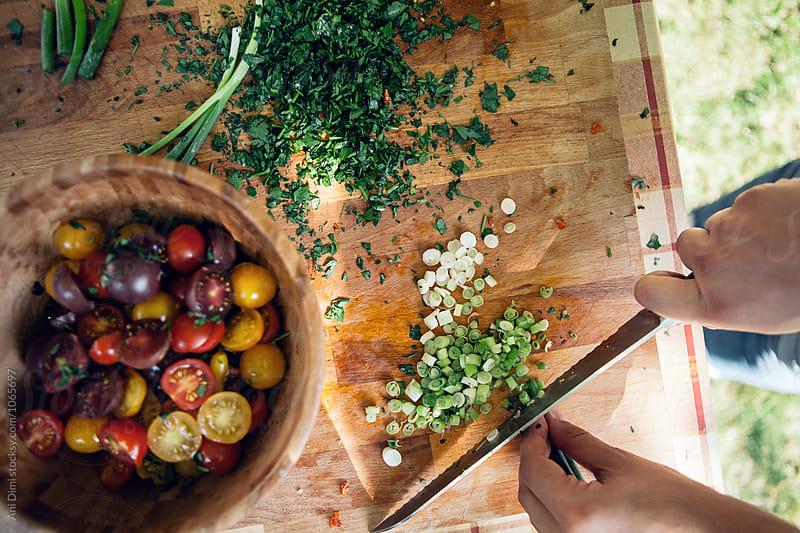 Preparing  salad  by Ani Dimi for Stocksy United