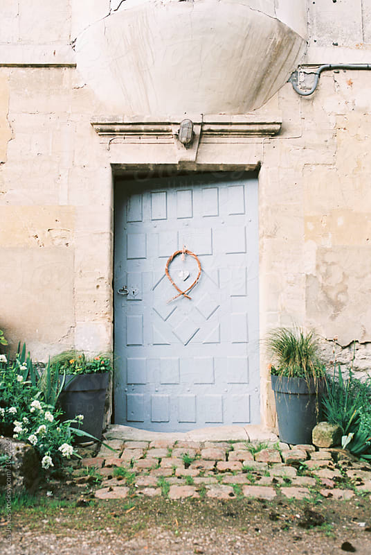 blue door on a old house by Léa Jones for Stocksy United