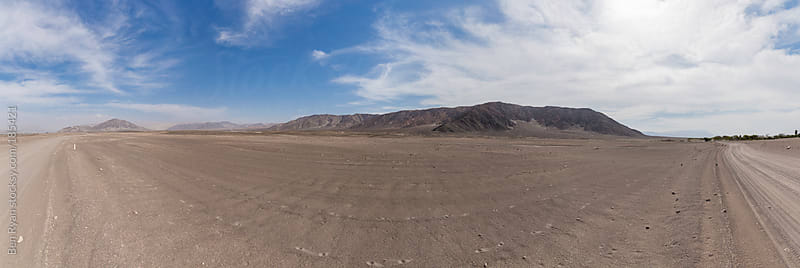 Panorama of barren valley with mountains in Chauchilla Peru by Ben Ryan for Stocksy United