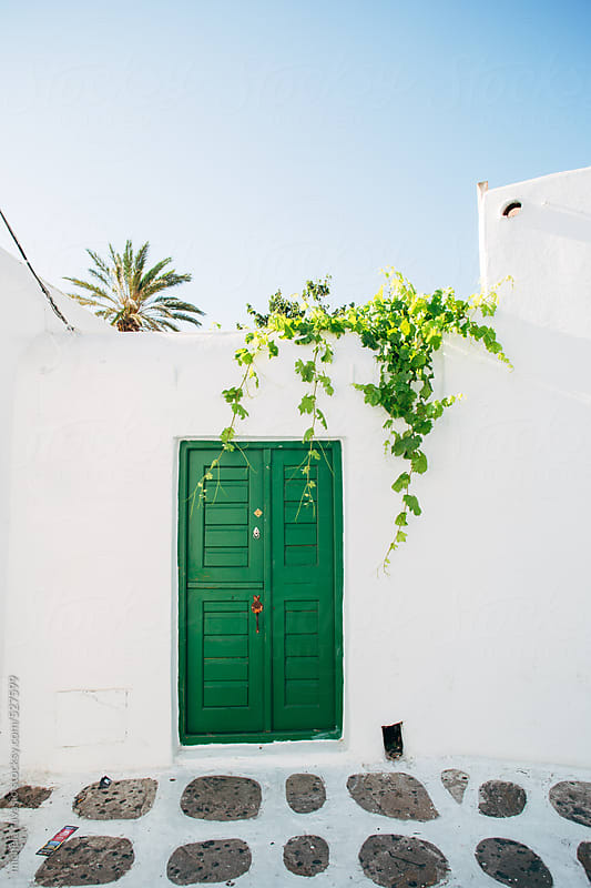 Green door in Mykonos by michela ravasio for Stocksy United