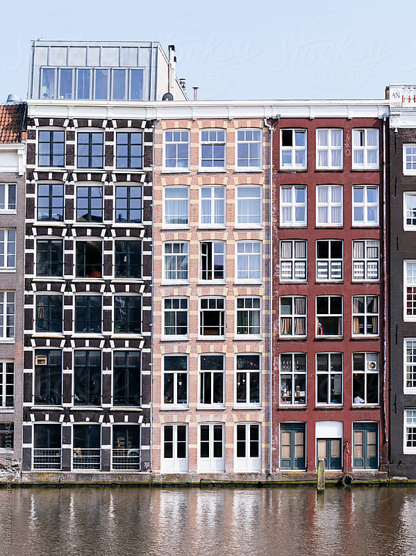 Canal houses in Amsterdam by Harald Walker for Stocksy United