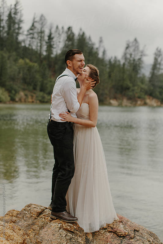 Portrait of Bride and Groom on Lake by Sidney Morgan for Stocksy United