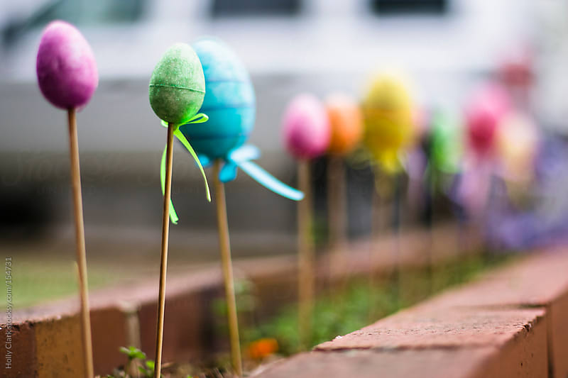 Colorful Easter decoration outside in Spring. by Holly Clark for Stocksy United