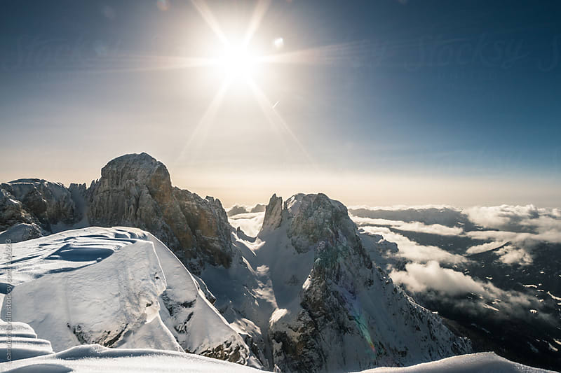 Snowcovered mountains in italian alps by Leander Nardin for Stocksy United
