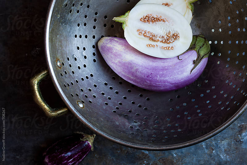 Colander with eggplants by Nadine Greeff for Stocksy United