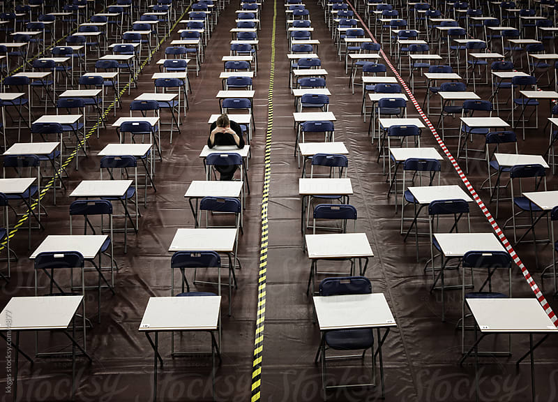 Exam hall with one student  by kkgas for Stocksy United