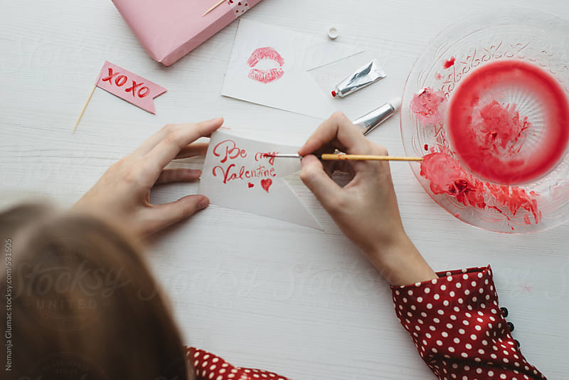 Woman Painting Romantic Cards For Valentine's Day by Nemanja Glumac for Stocksy United